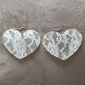 Preowned acrylic earrings with white lace insert.